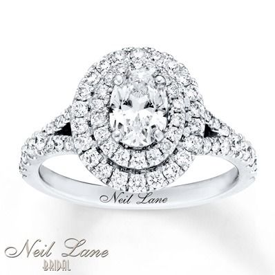 A double halo of round diamonds beautifully encircle the center oval in this exquisite Neil Lane Bridal engagement ring.