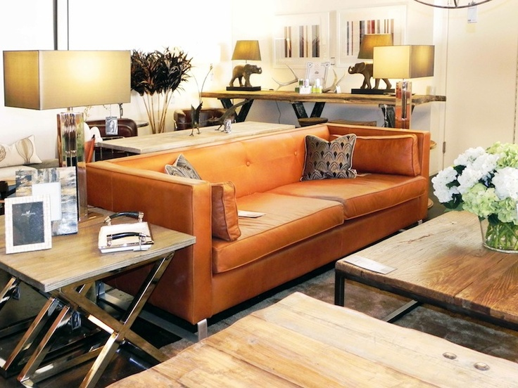 this burnt orange leather sofa is the essence of casual