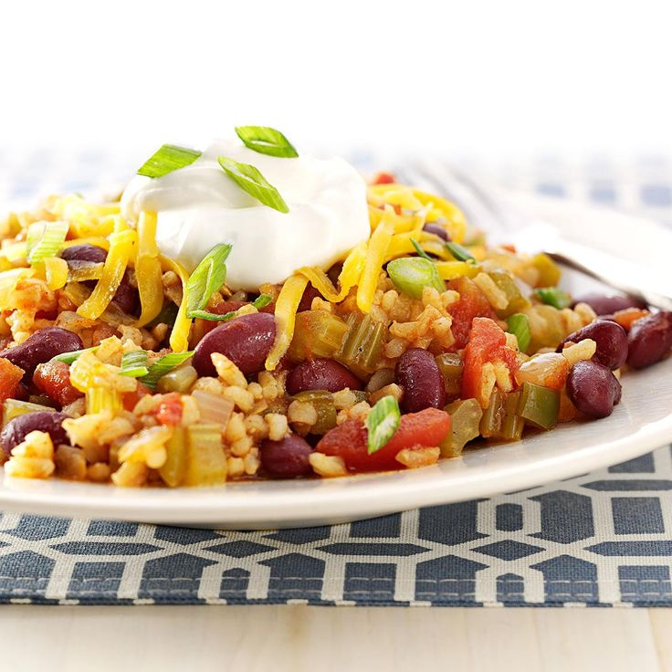 Mexican Beans and Rice Recipe -On cold or rainy days, this comforting dish really fills the tummy. Sometimes I switch up pinto beans for kidney beans or use white rice instead of brown. Add rolls and a green salad, and it's dinner! —Lorraine Caland, Shuniah, Ontario