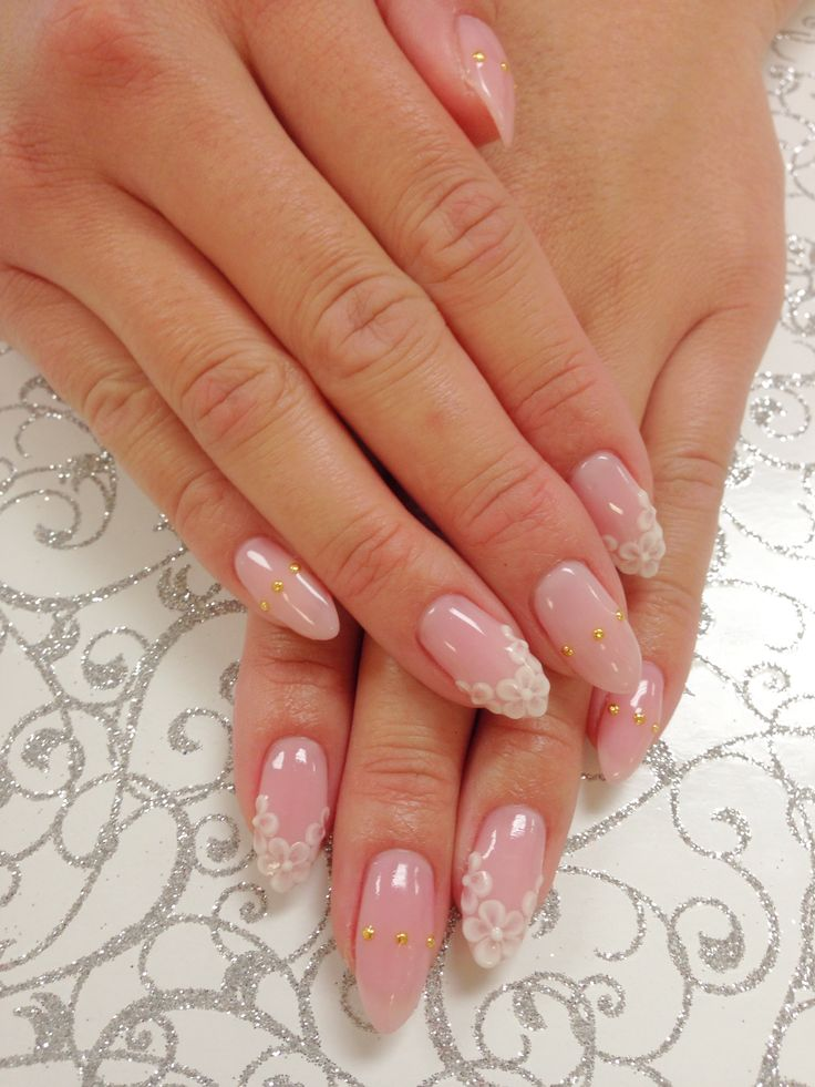 Japanese nail art with 3-D flower design.