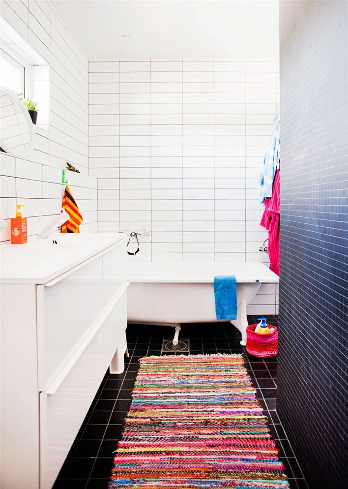 Rarely do I see a nice bathroom, even though some of us spend hours in it (for various reasons). This offers privacy, while still incorporating gorgeous white and black tile and a monolithic sink / bathroom