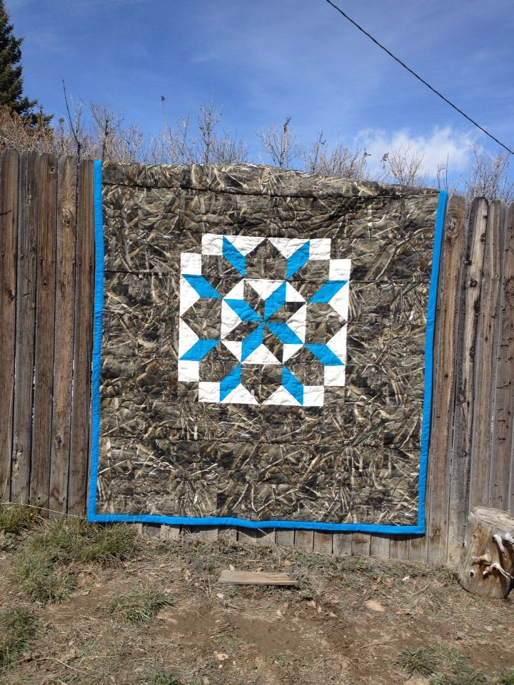 I saw a camo quilt with this star and had to make one. I made this quilt with max 5 camo and a blue star.