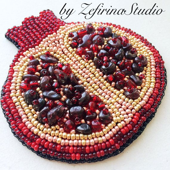 A brooch Red Pomegranate has a rich positive energy. Jewelry in the form of a Red Pomegranate is an emblem of vital energy and is regarded as a symbol of life, love, health and abundance. Brooch Red Pomegranate is hand embroidered from the Czech beads. Grains of pomegranate made of beads and natural stone garnet (agate). You will appreciate this luxurious jewelry. It will be a bright accent of your outfit. Brooch in the form of a pomegranate will be a wonderful gift for you or your loved…
