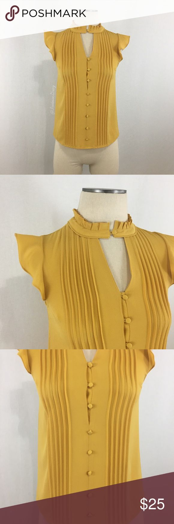 """ModCloth- Mustard Flutter Sleeve Pleat Top SZ XXS ModCloth- Mustard Flutter Sleeve Pleat Top SZ XXS. Made of 100% Polyester. Two sections of pleating down the front. Pleated collar with button closure at the neck- create a small v-cut out look at the chest. There are 8 buttons down the front (not including the neck)- the top 3 are functional, the bottom 5 are decorative. Buttons #4 & 8 are - little looser (see pic #3). Shoulder-bottom measures about 23"""" long. Armpit-armpit measures about…"""