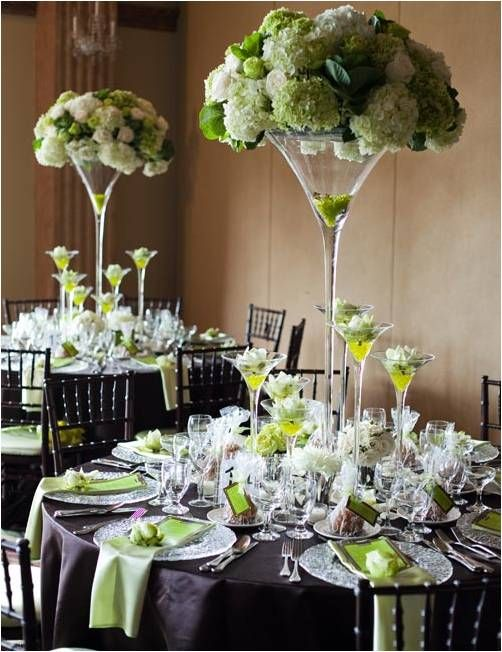 Decorating large martini glasses in floral displays can make elegant and unusual centre pieces for a wedding.