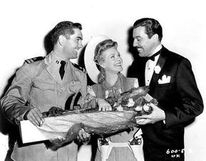 Image - Tyrone Power visits Alice Faye and Cesar Romero on the set