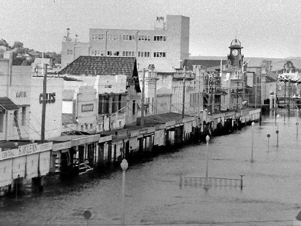 A picture from the Northern Star archives of water in Molesworth Street, Lismore, during the 1954 flood.