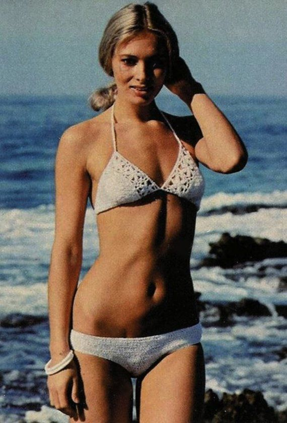 this reminds me of my mom's handmade crochet bikini....wonder if she still has the pattern somewhere? haha