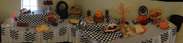 car themed baby shower tire cake and very unique centerpiece in the
