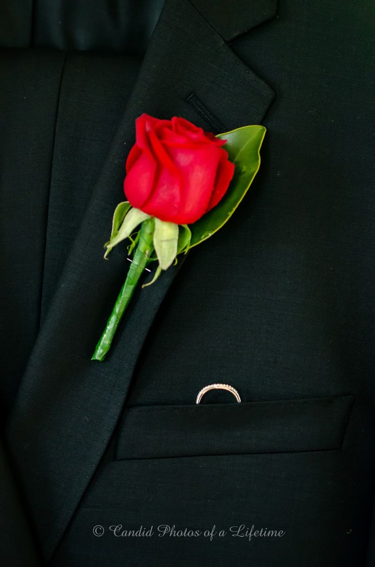 Wedding photographer, Candid Photos of a Lifetime  The groom's suit, with wedding ring & buttonhole flower