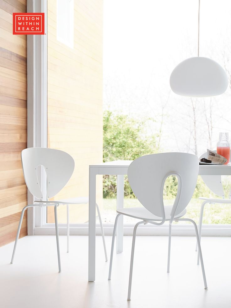 Keeping more than just the food fresh with all white Stua Globus Chairs designed by Jesus Gasca