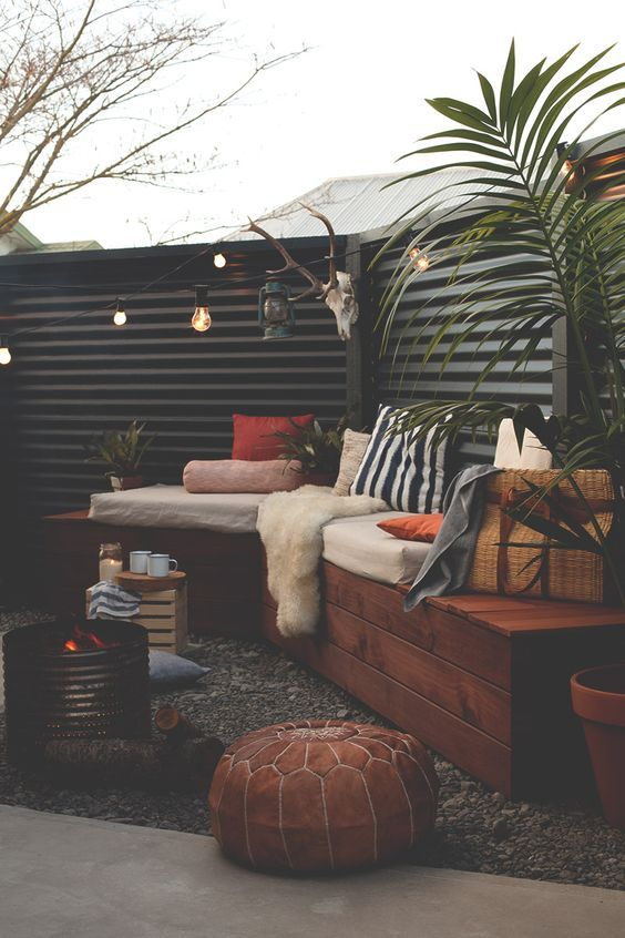 Corrugated metal for privacy.  I like the bench too, really everything except the animal head