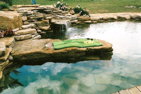 What we do not do is create clinical natural swimming pools, with clean swimming pool lines...we create rocky effects, such as beaches, rock steps, rock diving boards, cascades...