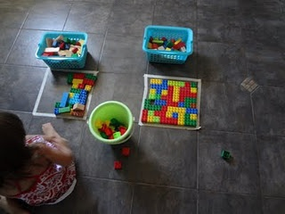 "Tape square, rectangle, pentagon, etc on floor.  Encourage children to fill in ""puzzle"" with duplos.  What else could we use to fill it in?"