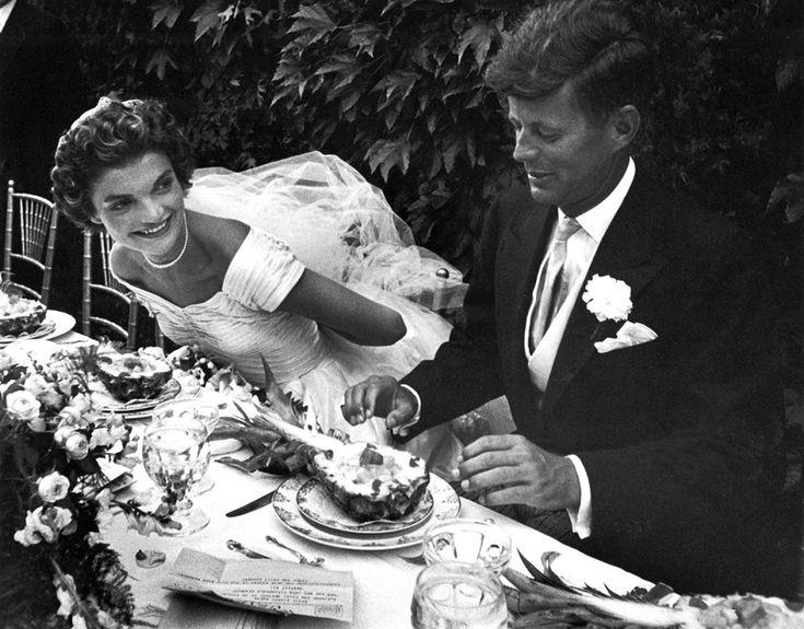 Sen. John F. Kennedy and his bride, Jacqueline, enjoy dinner at their outdoor wedding celebration in 1953