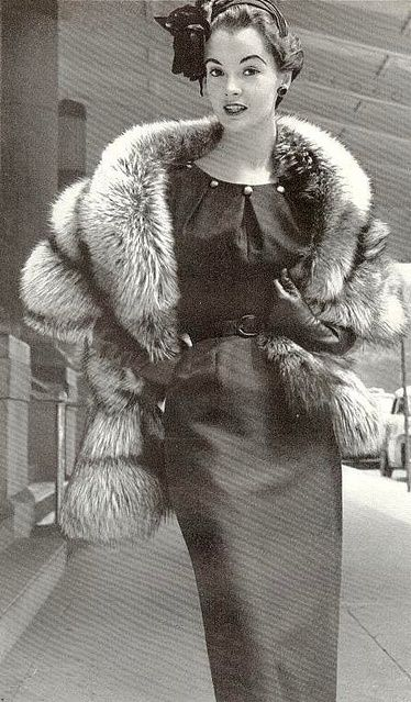 Silver fox stole over an elegant day dress, 1953