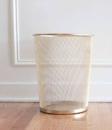 Gold Trash Can It's amazing what a can of gold spray paint can do. Transform your basic black waste bin into a golden décor item.