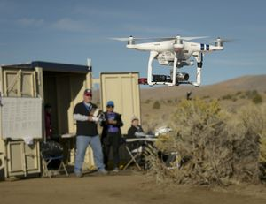 Drone Co-habitation Services operates a Phantom 3 commercial multi-rotor unmanned aircraft, one of 11 vehicles in the UTM TCL2 demonstration that will fly beyond line of sight of the pilot in command in Nevada test.<br><small>PHOTO: NASA AMES</small>