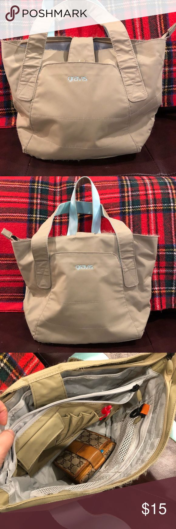 "Gravis tan bag with sea foam green accents Nylon shoulder bag. This bag is amazing! Pockets everywhere.  15"" x 11"" x 5.25"" 2 outside pockets, one clear divider pocket, large inside Velcro pocket, 2 mesh pockets, pen and phone holders.  A little beat up on the outside - the seams look frayed, but nothing is loose. I took a photo of the worst part. This is a tough bag!  The inside is in excellent shape. Interior is like new. GRAVIS Bags Shoulder Bags"