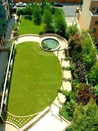 Truncated angled oval lawn in a long narrow garden design.