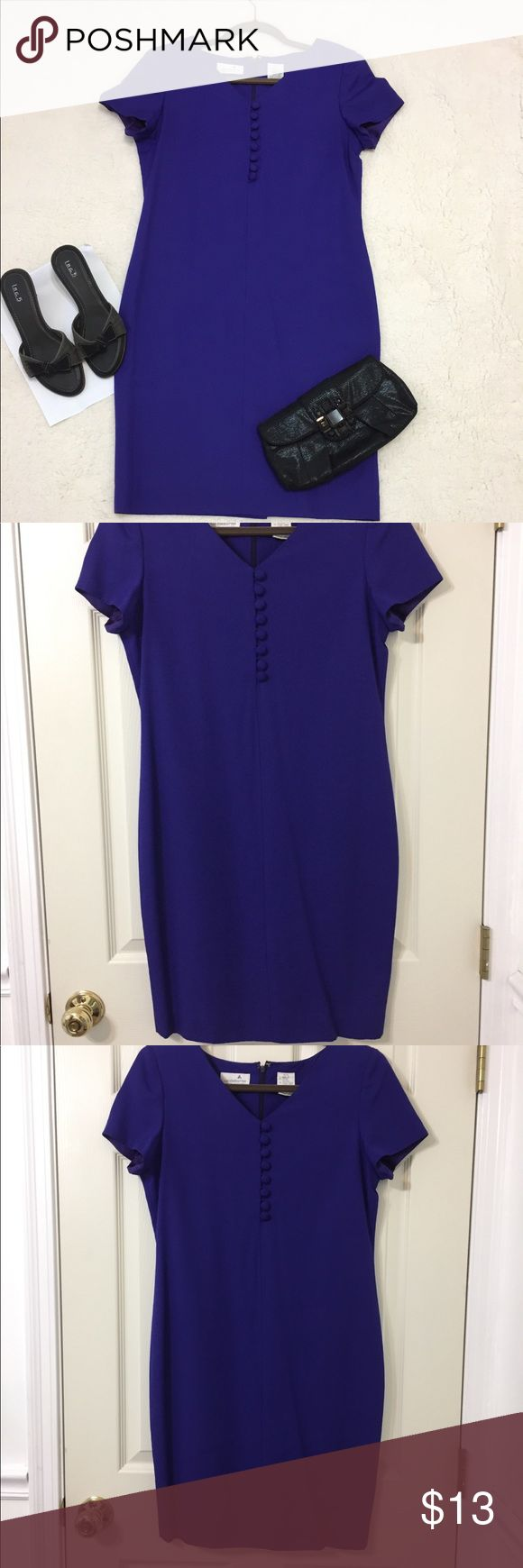 Liz Claiborne Royal blue Petite dress Stunning Dress in Rich Royal blue dress with short sleeve , buttons and has small slit in the back. Very good Condition except discoloration inside the arms(As shown in Pictures). Liz Claiborne Dresses