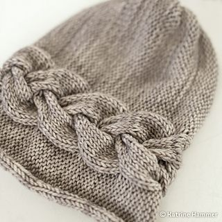 Cute and soft beanie, knitted sideways with one beautiful