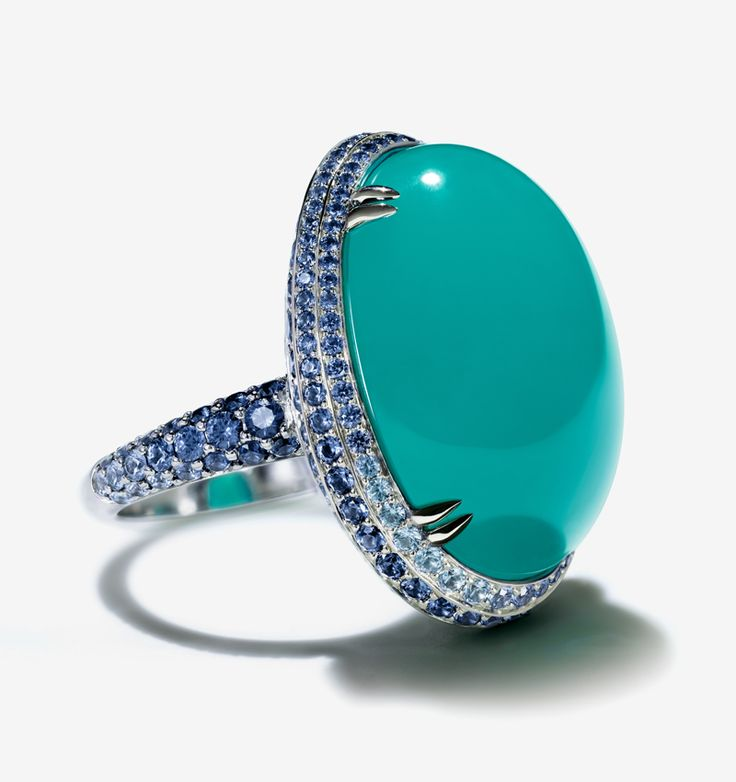 This ring's center stone, a chrysocolla cabochon, is evenly saturated with the color of an idyllic tropical sea.