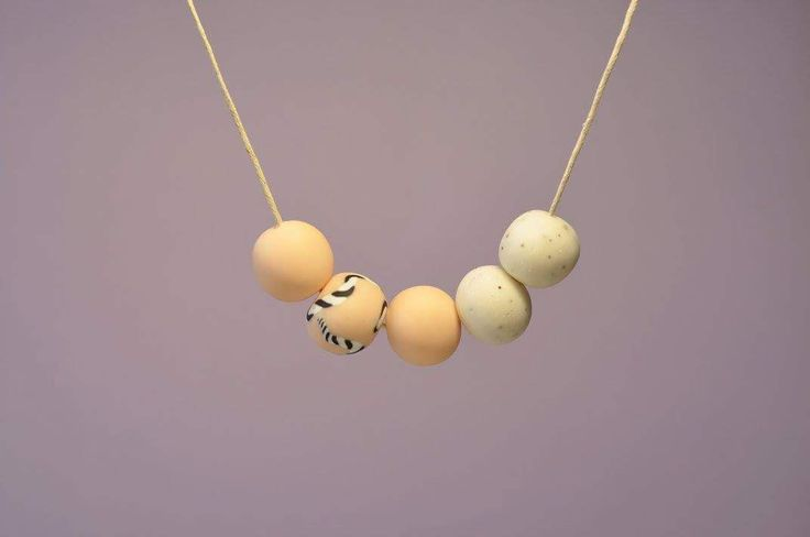'Soft breeze', handmade polymer clay necklace made from a combination of soft pastel blush and white round stones as part of our SPRING collection.