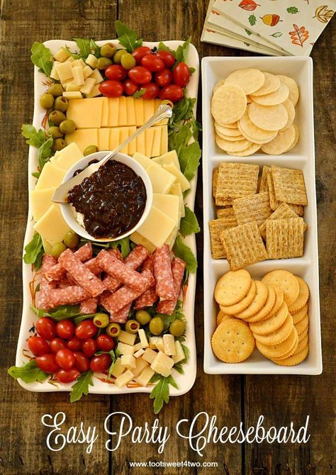 Can never have enough presentation ideas for appéritif time. Triscuits, Ritz too with olives cherry tomatoes and salami. Easy Party Cheeseboard - simple ingredients, big flavor!