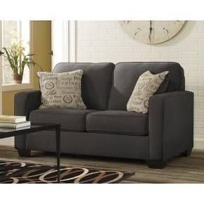 Give yourself or your guests a comfortable spot to sit with this Vintage Casual Loveseat from Ashley Furniture. The two-cushioned loveseat is the perfect size to complement your full-sized couch or to leave on its own in your cozy living space. All you need is a comfortable blanket and you're set for a cozy night in thanks to the included accent pillows.