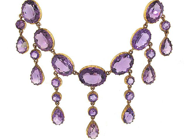 This romantic late Georgian necklace contains an array of oval amethysts with graduating drops of dangling round and pear shape amethysts. These gemstones are set in classic Victorian baskets each with thirteen prongs. Circa 1845