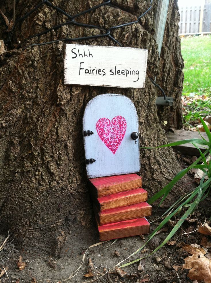 I'm not a huge fan of the sign, but how cool would it be to overnight transform a tree into a fairy house with doors and windows? I think it would be cool for kids :)