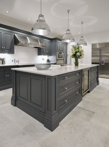 ? EEDS DIFFERENT HANDLES.  I LIK E THE HOOD.  YOUR CABINETS WILL GO TO THE CEILING.   HATE THE INDUSTRIAL LIGHTS. Luxury Grey Kitchen – Tom Howley