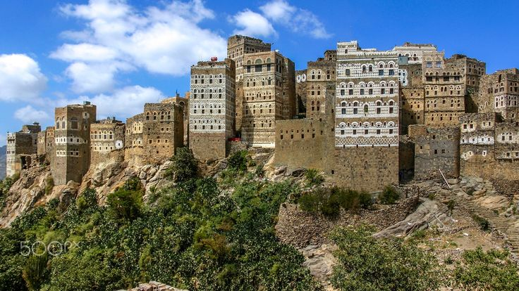 Yemen , travel memories - november 13 2006 - Al Hajjara,Yemen.A city built at the top of a mountain,in the Haraz Mountains, upon a precipice and famous for its towering stone buildings  decorated with elaborate and typical white freezes and patterns.   october 6 2015 - read some time ago that maybe that wonderful city doesn't exist anymore...maybe ..  re-edition ,new version ,tribute to Yemeni people who's suffering so much..
