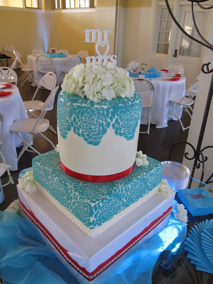 """Red and Aqua wedding cake with, but seein gmore of an """"indian"""" inspired pattern"""