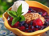 Slow-cooker mixed berry cobbler.  Ridiculously easy - make with any frozen berries.