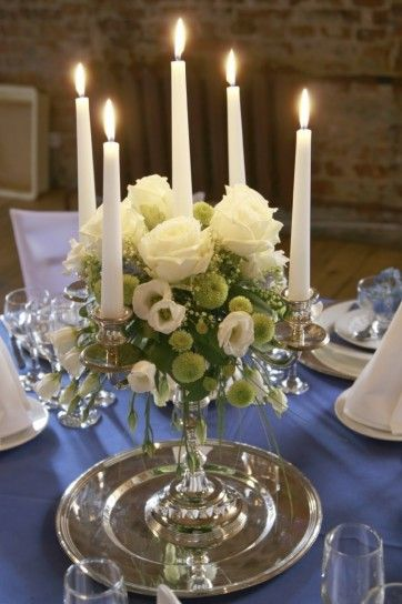 ARRANGEMENT: | Flowers Arrangement + On Top of Candelabra + placed on a Matching Silver Plate.