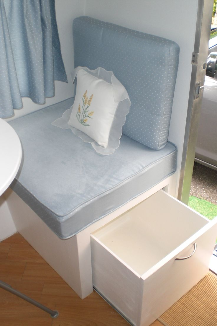 Vintage trailer - great storage idea, slide out drawer under seat instead of having to remove cushions!