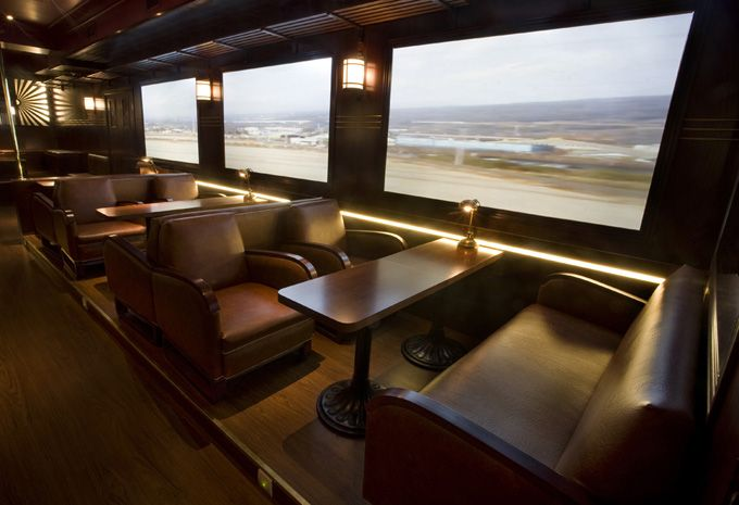 """The Passenger - a restaurant and bar in Madrid/Spain that uses video screens as """"windows"""" - to replicate the feeling of dining in a luxury passenger train.  Cool."""