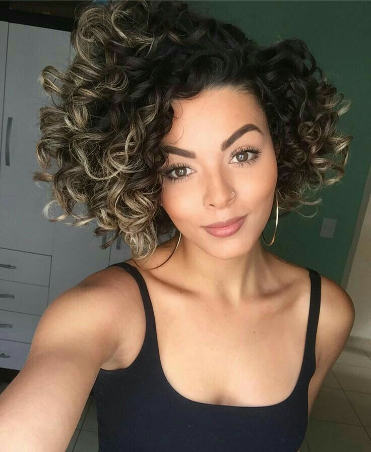 She is absolutely gorgeous.  I womder if the hair is all natural. Real or not. She really rocks these curls.