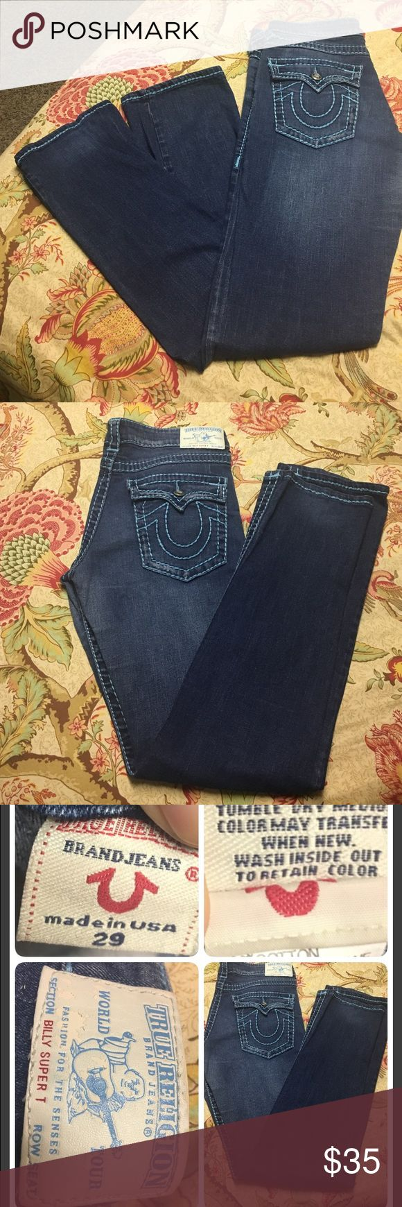 True Religion Jean True religions with turquoise/blue stitching older style jeans with Swarovski buttons. So very cute. Some of the stitching is loose as shown in certain areas. Other wise in great shape. Smoke free home True Religion Jeans Boot Cut