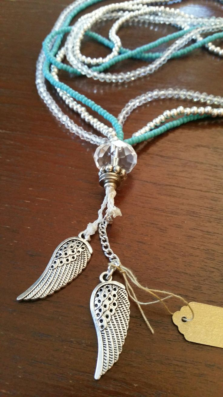 Handmade turquoise and crystal lanyard with friendship wings.