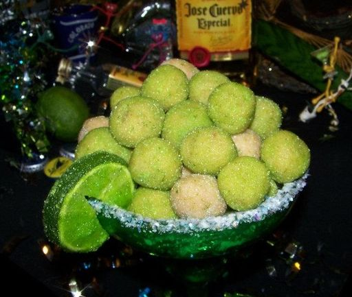 Ready for Margarita Balls? Guarantee your invite to everyone's party with this recipe for Margarita Balls! Directions: Mix vanilla wafers and almonds until they are very finely ground. Melt white c...