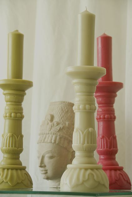 a candle and holder all in beeswax