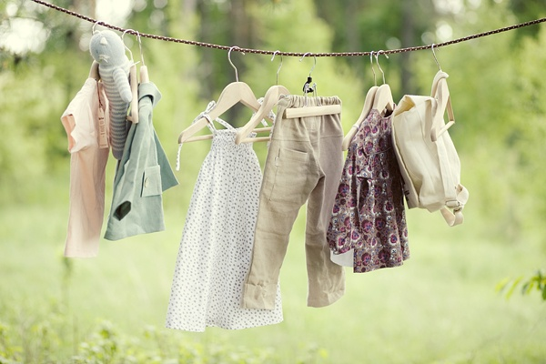 a clothesline with kids in front of it would be cute!  now to find cute wood hangers!
