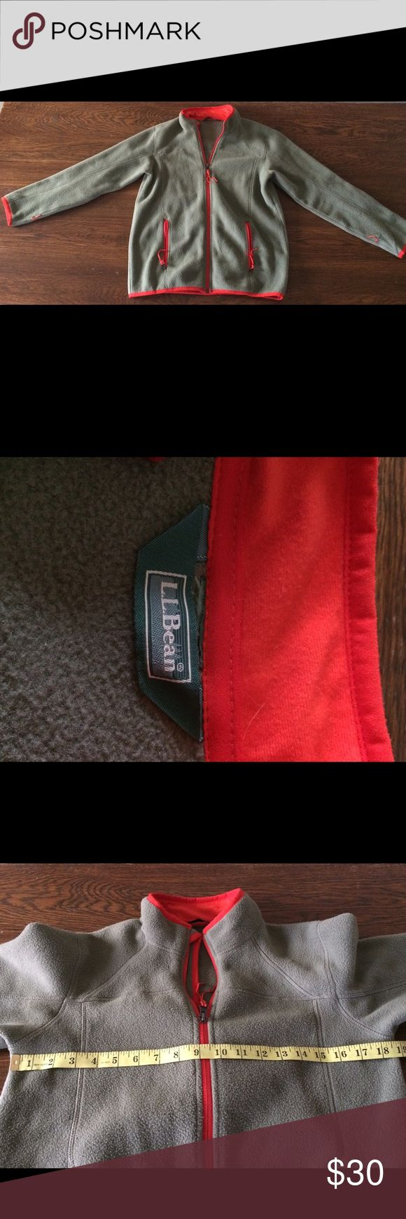 LL Bean Women's Zip Up Fleece Jacket Olive Green Body. Red Orange piping and zipper Detail. Size tag is missing. *Please see pictures for measuring for better idea of fit. Good Condition. *See picture with name label used. Double outerwear system. Thank you for visiting my closet. If you have any questions please let me. Thank you! L.L. Bean Jackets & Coats