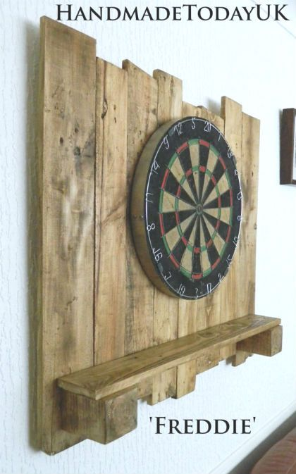 Great use of driftwood to make a dartboard surround and shelf!