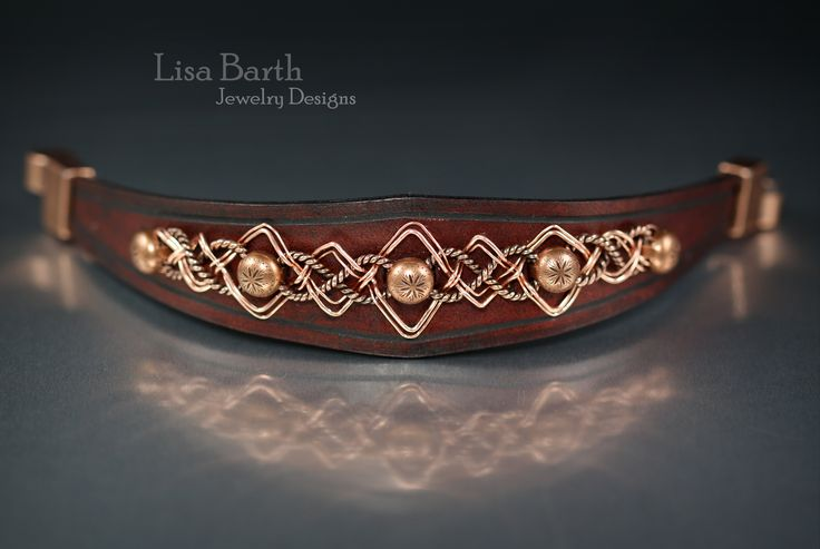 Hand woven Celtic design with hand cut and dyed leather.   -Lisa Barth