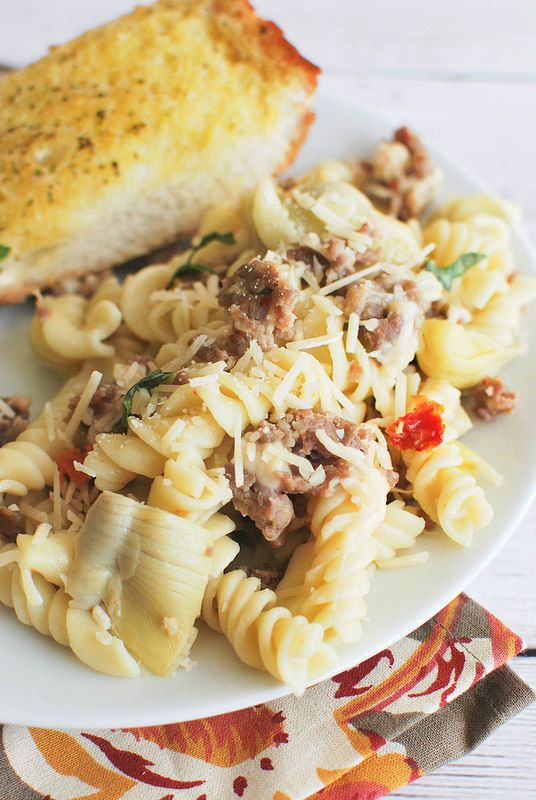 Pasta with Sausage, Artichokes, and Sun-Dried Tomatoes - a light pasta recipe that's perfect for a weeknight.
