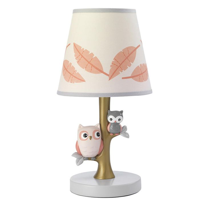 These two friendly little owls sitting in a tree were designed exclusively for Babies R Us by Lambs & Ivy®. Their favorite tree has a golden tone and each wise owl is perched on its own branch. The coordinating shade is a candlelight pink color with pretty printed feathers. This lamp is polyresin and is painted in a shiny high gloss paint. The lamp is approximately 10 inch tall from base to top of shade and comes complete with an energy efficient 13 CFL watt light bulb for environ...